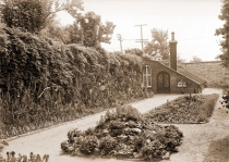 Image of Cactus garden located at the northeast corner of Linnaean garden or near Tower Grove and Russell Avenues.  Picture probably made in late l890's or early l900's.  Small lean-to greenhouse visible.