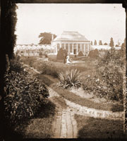Image of View of Main Conservatory (1868-1916) with man and woman visible in the foreground.  Note: Juno is not in Parterre which would indicate picture was made in early 1880s.