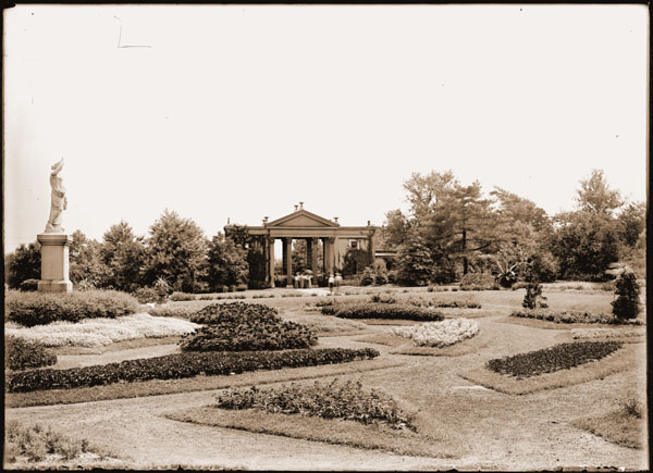 Image of View of the Main Garden Parterre in the 1890's.   Visitors visible near Main Gate and Juno.  One 7x5 in. sepia print.