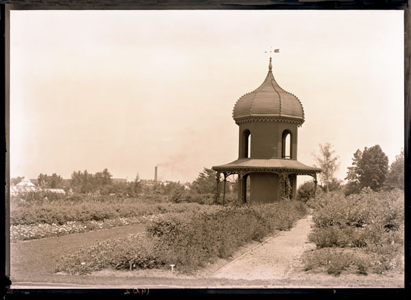 Image of Observatory with garden view.  Grass walk with Crataegus hedge bordered with coreopsis and verbena.  View is to the northeast.  5x7 prints.  Copy Negative available at PHO 2006-2807.  PRINTS AVAILABLE -- SEE PHO 1982-0040, PHO 2006-2806.