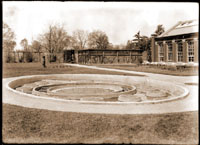 Image of Lily pool showing details of Victoria pool with hot water pipes. This pool was between the greenhouse and the Linnaean House.