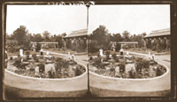 Image of Victoria regia pond in front of the Linnean House with ladies standing around it.
