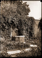 Image of Linnaean Garden with Lion Head Fountain and wall visible, from east end of Linnaean Garden.