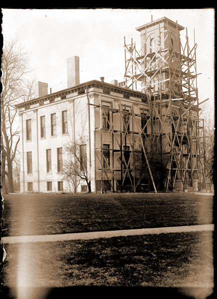 Image of Tower Grove House being stuccoed. (shows scaffolding). Vertical orientation.  1- 5x7 in. print.