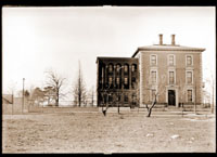 Image of Administration Building, formally Henry Shaw's townhouse, before addition also known as the Herbarium-Library Building, . Shows 2 historic bald cypresses.  Copy negative(s) available.  Print available at PHO 1982-0160