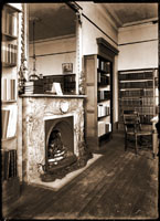 Image of Administration Building interior.  Study room located on the first floor, north end of building. Fireplace flanked by bookshelves.  Folio books were kept in this room which was Nell Horner and Taddy Mepham's office.  PRINT AVAILABLE:  SEE PHO 91-0016