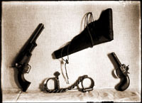 Image of Henry Shaw Memorabilia.  Revolver, holster, pistol, handcuffs.  No date.  Disappeared when on display in Tower Grove House sometime after renovation in the 1950's.