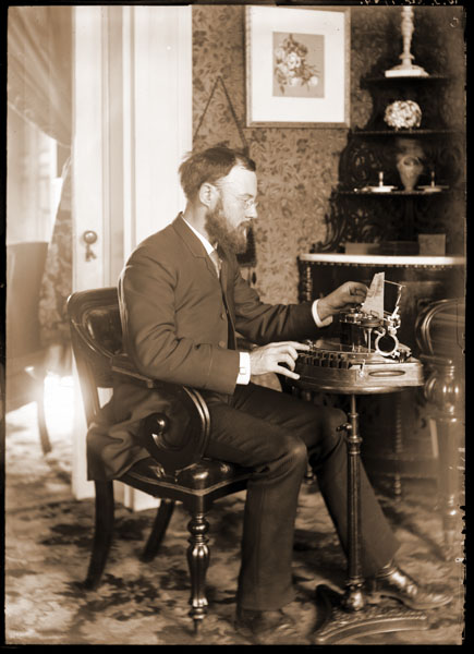 Image of Dr. William Trelease in office at typewriter.  Interior of Tower Grove House.  Print available at PHO 2007-1212.