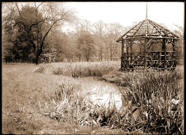 Image of Henry Shaw's Arboretum.  View of Central section of Arboretum stream.  Rustic summer house.