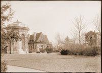 Image of View looking south-east toward east wall.  Victory, Cleveland Ave. Gatehouse, and  Museum visible.  Shows iron fencing around Mausoleum grove.  Print available at PHO 2007-1547.