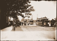 Image of Open Sunday at the Garden. Street cars on Tower Grove Ave. with people streaming from the Main Gate to the cars.  Two 7x5 in. prints.  Copy negative available.