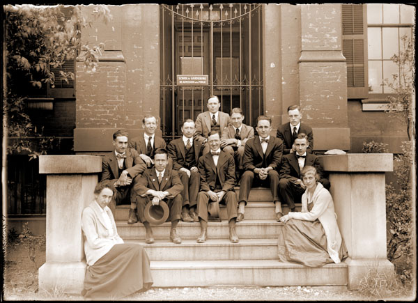 Image of School of Gardening.  Students and instructors on the steps of Tower Grove House at graduation.  Top: Dr. Moore. Backrow: Pring, Lurie, Monteith, C. Pedlow, Ellis.  Mid Row: G. Pedlow, Noyes, Kohl, Cella.   Front Row:  Miss Fuhr, Miss Corley.  2- 7x5 in. prints.