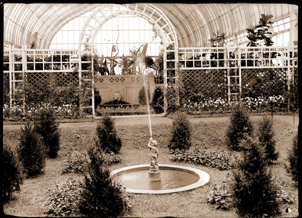 Image of Shakespearean Garden in Floral Display House with view toward south end with pool and nymph fountain in center.