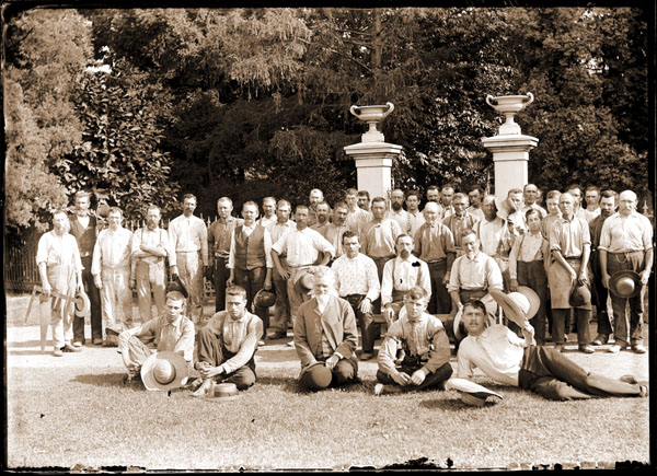 Image of Gardeners and staff in front of entrance gate to Mausoleum grounds.  In this image Gurney is looking straight ahead. (Envelope in Trelease's handwriting.) Same group and day as GPN82-0335.  1 7x5 in. print. For copy negative see GPP 1981-0013