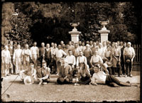 Image of Gardening staff posed in front of Mausoleum grounds. This portrait shows Gurney in front, looking slightly to the right. This is the image used in the 'World of Plants' publication. (Envelope in Trelease's handwriting.) Same group and day as GPN 1982-0334.  PRINT AVAILABLE -- SEE PHO 2006-0796.
