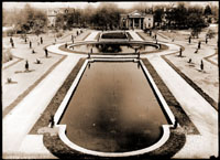 Image of Newly finished lily pools.  The new pools were lined up with Flora Ave. which had been redone as it exists today.  The original Main Gate is visible in the background and is lined up with the location of the old Flora Blvd.  PRINT AVAILABLE -- SEE PHO 1982-0347.