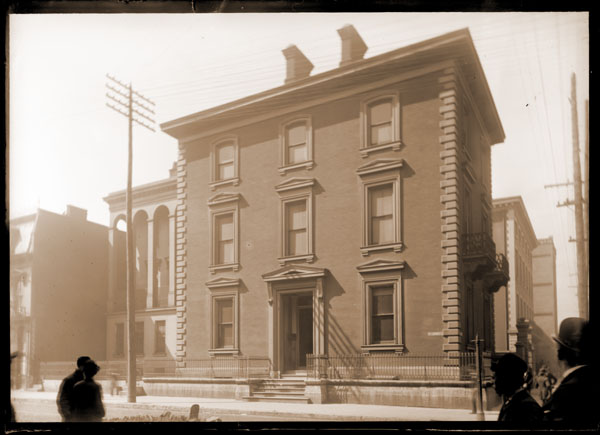 Image of Henry Shaw's Townhouse  Located at 7th & Locust just before removal in 1891 to the Missouri Botanical Garden at 2315 Tower Grove Avenue. People on street.  PRINTS AVAILABLE -- SEE PHO 1980-0653.  Copy negatives available.  See also PML 1980-0653.