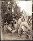 Image of Mexican standing beside plant. (Possibly August 26, 1903)