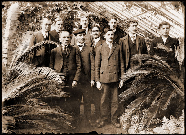 Image of Garden employees, picture taken in greenhouse in 1906.  George Pring is standing in back row, third from the left.