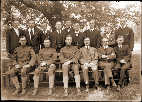 Image of Group of graduate students and teaching staff, picture taken in 1917.   Front row, left to right:  Freiburg Severy; Dr. George T. Moore, Dr. Benjamin Dugger, and Jesse M. Greenman.  Back row, left to right:  Alex Laurie, seven unidentified students.