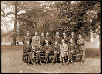 Image of Group of graduate students and teaching staff, picture taken in 1917. Top row, 2nd from right - Dr. Carrol Dodge.  Front row, left to right - Jesse Greenman, Herman von Schrenk, George T. Moore,  and three others.  2- 5x7 in. prints.