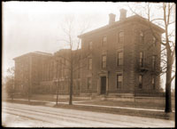 Image of View of the Herbarium-Library Building. Left half was built in 1908 and added to right half which originally stood at 7th and Locust Streets and was moved to the Garden in 1891.  Two copy negatives available at PHO 1983-0381.