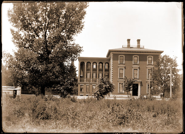 Image of Administration Building after being moved from 7th and Locust.  Street car can be seen on the left.  Copy negatives and prints available at PHO 1983-0388.