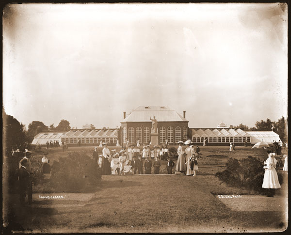 Image of View of the 1868 Main Conservatory to the north with various visitors in the foreground.  Original image entitled 'Shaw's Garden'.  E. Boehl photographer.