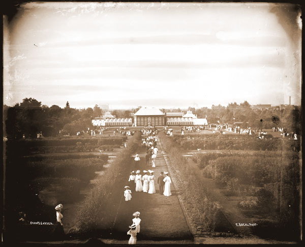 Image of View of the 1868 Main Conservatory looking north with many visitors in the foreground.  The image was probably taken from top of the Observatory.  Image originally entitled 'Shaw's Garden.'  E. Boehl, photographer.   Postcard made from negative, dated 1910.
