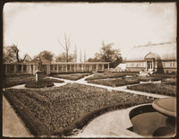 Image of Mediterranean House and Italian Garden with tulips.  Juno and Portico in view.