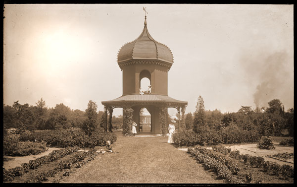 Image of Observatory with people on both levels and on path.  View is to the north with Juno and the Main Conservatory visible through Observatory entry way.