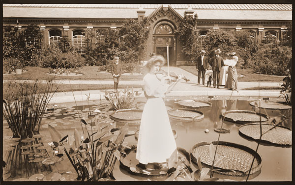 Image of Lady playing violin standing on Victoria pad in front of the