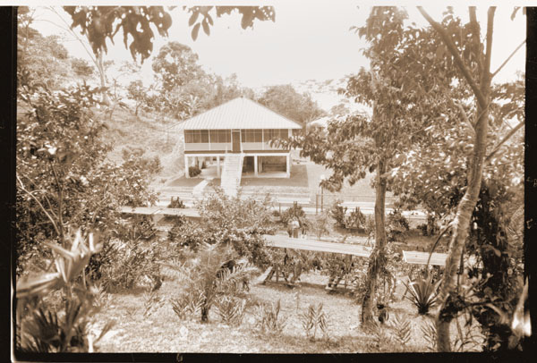 Image of View of house and shelters; 5 x 7 negative.  Print available at PHO 2007-0352 and PHO 2007-0353.