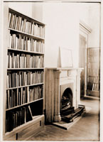 Image of Fireplace flanked by bookshelves.  Differs from PHO 91-0016 -- different fireplace, different room.  Date is circa 1893. 2 copies of print, one adhered to cardboard.
