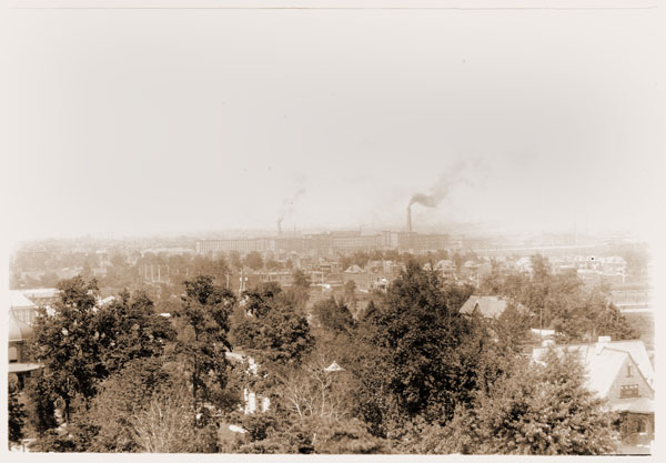 Image of Aerial view of St. Louis from Tower Grove House.  Two images pasted on cardboard; one shows smoke from factories, other includes part of MBG.  Copy negative available.