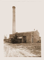 Image of Image of boiler house, probably during early years of Garden construction, dirt lot surrounding it.