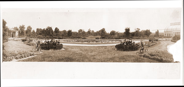 Image of Panoramic shot of central lily ponds, with Conservatory on the right, and main gate on the left.