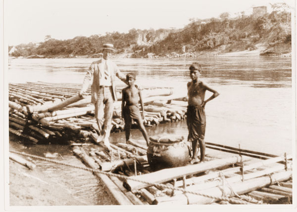 Image of Scene of Expedition.  Copy negative available.  Arrival at Gradiot, showing the double bamboo raft in background.  George Pring upon raft.  MBG Bull. 11: pl. 21 opp. P. 88. 1923.
