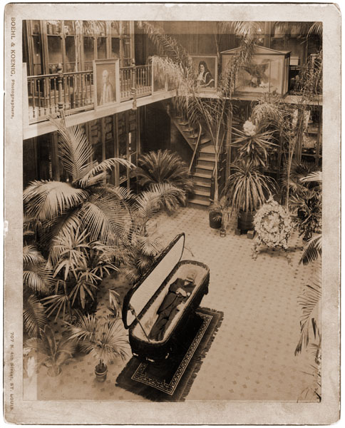 Image of Lying in state in Museum Building, 1889.  The paintings along the upstairs banister are now located in the Missouri Botanical Garden Library.