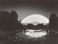 Image of Climatron exterior. Climatron at night as reflected in tropical lily pools. Circa 1970.