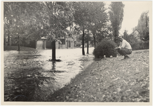 Image of Windstorm and hail damage 1 Sep 46.  Flooding of streets.