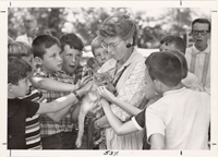 Image of Virginia Hay, volunteer guide. With school children
