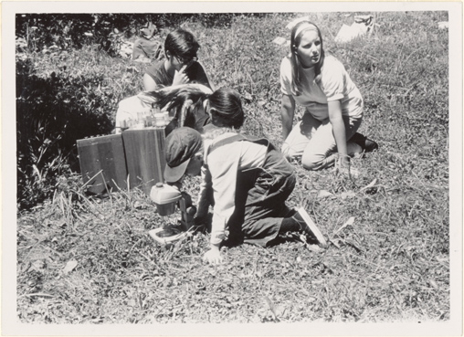 Image of Pitzman Program.  Children in the Garden's Pitzman Program study pond life on the edge of the Arboretum's Pinetum Lake.  Summer of 1971.  Bulletin Jan-Feb 1972, pg. 30.