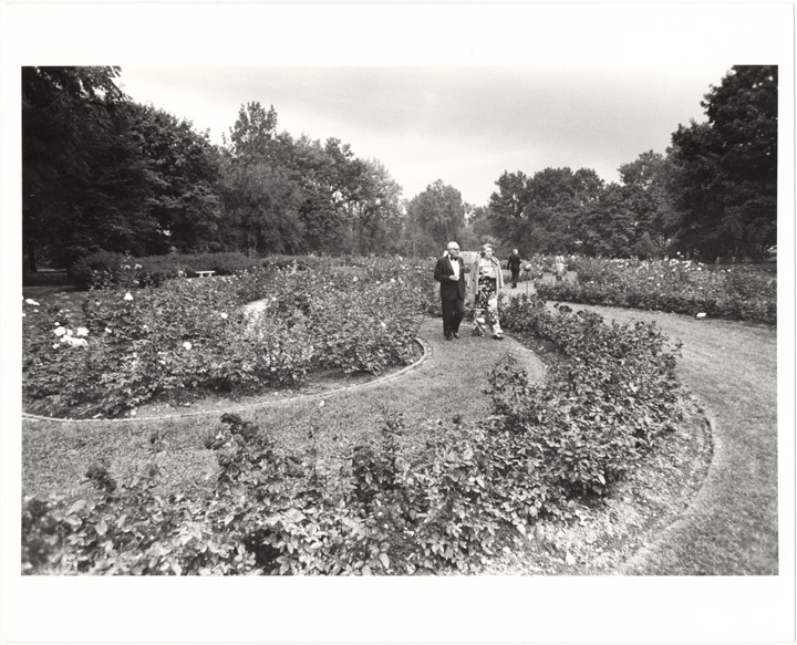 Image of English Garden Party. 20 September 1974. Guests strolling thru South Rose Garden prior to fashion show.