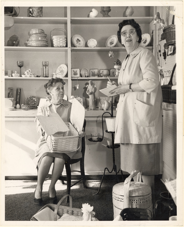 Image of Garden Gate Shop inventory.  Mrs. Frank Vesser, chairman of Tower Grove Shop, and Mrs. Jerome F. Kircher, chairman of Volunteers, taking inventory at the shop.
