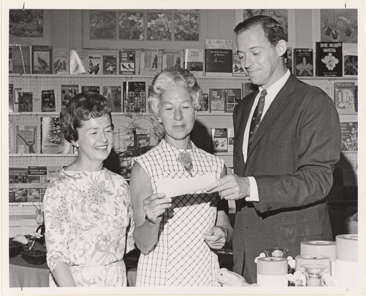 Image of Harry Wuertenbaecher receives $19,000 check from Mrs. Wm. Robinson (rt.) and Mrs. Fred Wezel (lf), co-chairmen of the Garden Gate Shop.  This represents the net proceeds from shop during 1966-67.  Same as PHO 2006-0689.  MBG, Vol. 55, No. 7, pg. 23.