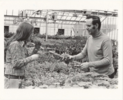 Image of Robert Dingwall and Susan Dingwall looking at herbs in Headhouse.