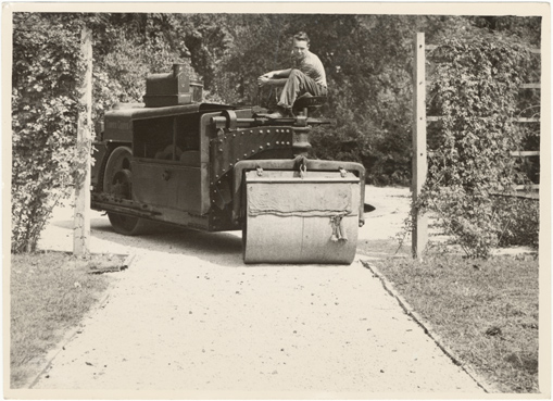 Image of Paving middle pathway in Economic Garden late 1940's.  Rolling 1\2 macadam after application of
