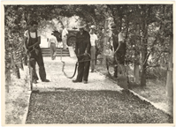 Image of Paving middle pathway in Economic Garden late 1940's.  Spraying