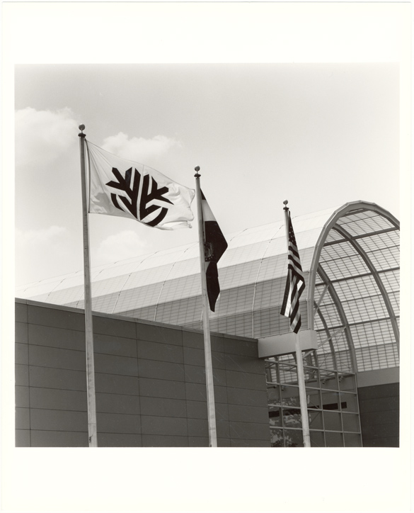 Image of Ridgway Center, exterior.  Front entrance with flags.
